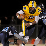 Cape Fear's Justice Galloway-velazquez rushes against Hoggard's Will Kandare, left, and Hashim Michel Friday November 21, 2014 at Hoggard High School in Wilmington, N.C. (Jason A. Frizzelle)