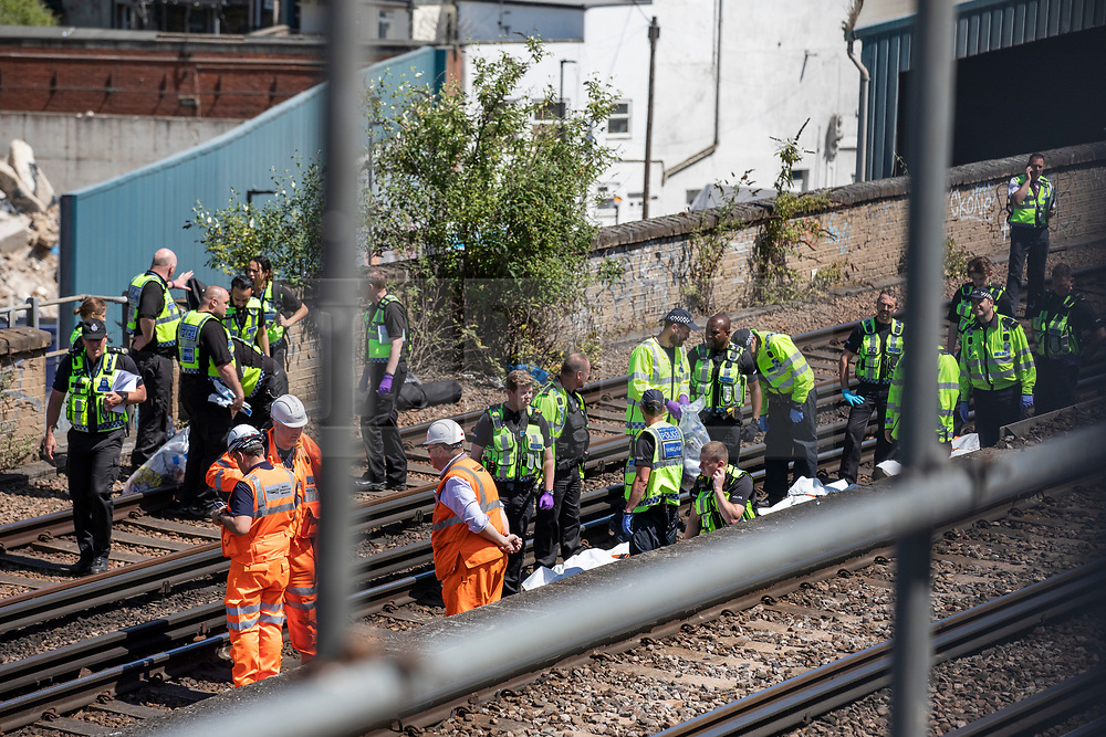 © Licensed to London News Pictures. 18/06/2018. London, UK. Police officers are seen on the train tracks near Loughborough Junction station where three bodies were discovered after they were reportedly hit by a train. Photo credit: Rob Pinney/LNP