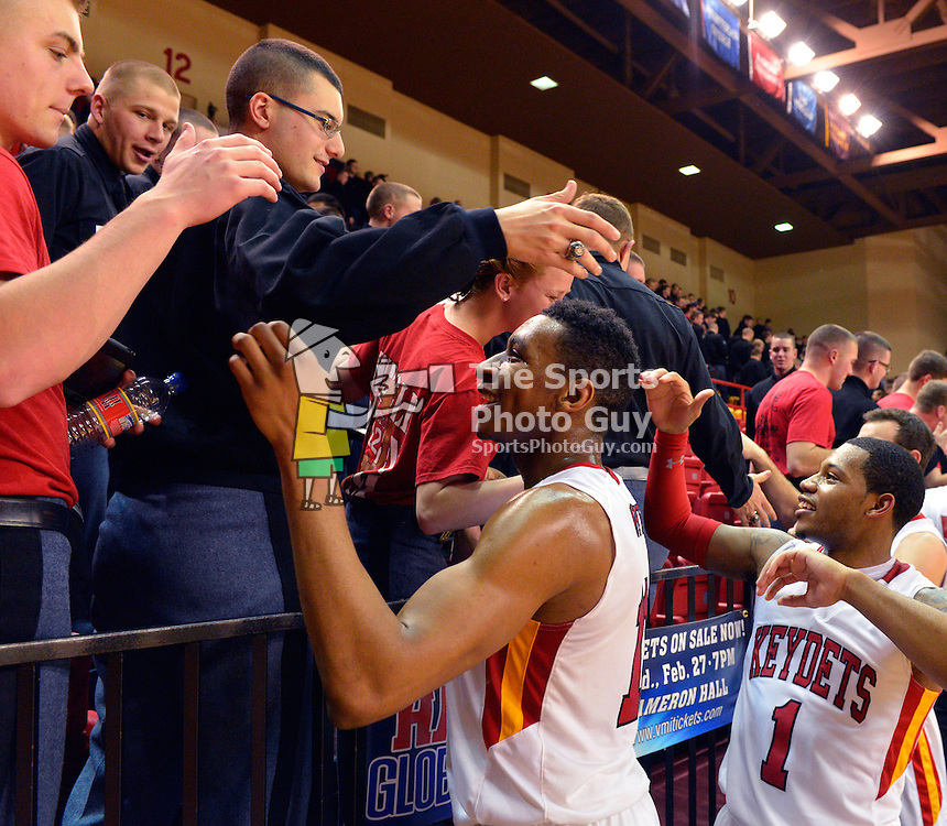 NCAA Men's Basketball - VMI rides decisive 2nd half to put down Camels, remain unbeaten in Big South play: Stan Okoye (center) and Rodney Glasgow (right) are congratulated by members of the VMI Corps of Cadets after the Keydets' decisive victory over Campbell on Wednesday night in Lexington.