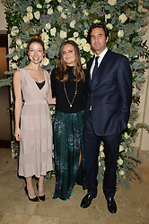 Left to right, SOPHIE COUTTS-WOOD, LADY NATASHA RUFUS ISAACS and her husband RUPERT FINCH at a private view of the Beulah Winter Autumn Winter collection entitled 'Chrysalis' held at The South Kensington Club, London SW7 on 24th September 2015.