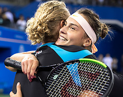 WUHAN, Sept. 29, 2018  Aryna Sabalenka (R) of Belarus hugs her coach after winning the singles final match against Anett Kontaveit of Estonia at the 2018 WTA Wuhan Open tennis tournament in Wuhan, central China's Hubei Province, on Sept. 29, 2018. Aryna Sabalenka won 2-0 and claimed the title. (Credit Image: © Xiong Qi/Xinhua via ZUMA Wire)