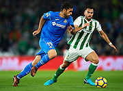 SEVILLE, SPAIN - NOVEMBER 03:  Jorge Molina of Getafe CF (L) being followed by Jordi Amat of Real Betis Balompie (R) during the La Liga match between Real Betis and Getafe at Estadio Benito Villamarin  on November 3, 2017 in Seville, .  (Photo by Aitor Alcalde Colomer/Getty Images)