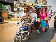 27 FEBRUARY 2015 - PHNOM PENH, CAMBODIA:  A motorcycle pulled tuk-tuk is used as a bus in rural Cambodia.   PHOTO BY JACK KURTZ