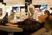 A lady passenger has eyebrow threading treatment during beauty session at the Blink Eyebrow Bar in World Duty Free Heathrow's T5