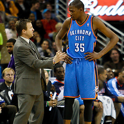 January 24,  2011; New Orleans, LA, USA; Oklahoma City Thunder head coach Scott Brooks talks with small forward Kevin Durant (35) during the second half of a game against the New Orleans Hornets at the New Orleans Arena. The Hornets defeated the Thunder 91-89. Mandatory Credit: Derick E. Hingle