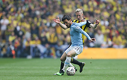 David Silva of Manchester City holds off a challenge from Will Hughes of Watford - Mandatory by-line: Arron Gent/JMP - 18/05/2019 - FOOTBALL - Wembley Stadium - London, England - Manchester City v Watford - Emirates FA Cup Final