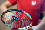 Jaroslaw Duda - stringer of Polish Tennis National Team prepares raquets while training session one day before the BNP Paribas Davis Cup 2014 between Poland and Croatia at Torwar Hall in Warsaw on April 3, 2014.<br /> <br /> Poland, Warsaw, April 3, 2014<br /> <br /> Picture also available in RAW (NEF) or TIFF format on special request.<br /> <br /> For editorial use only. Any commercial or promotional use requires permission.<br /> <br /> Mandatory credit:<br /> Photo by &copy; Adam Nurkiewicz / Mediasport