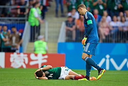 MOSCOW, RUSSIA - Sunday, June 17, 2018: Mexico's Javier Hernandez lies injured as Germany's goalkeeper Manuel Neuer looks on during the FIFA World Cup Russia 2018 Group F match between Germany and Mexico at the Luzhniki Stadium. (Pic by David Rawcliffe/Propaganda)