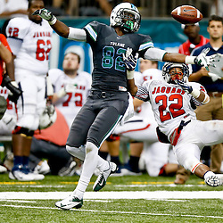 Sep 7, 2013; New Orleans, LA, USA; South Alabama Jaguars cornerback Qudarius Ford (22) breaks up a pass to Tulane Green Wave wide receiver Xavier Rush (82) that resulted in a interception during the second half of a game at the Mercedes-Benz Superdome. South Alabama defeated Tulane 41-39. Mandatory Credit: Derick E. Hingle-USA TODAY Sports