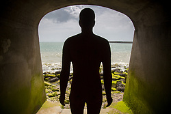 "@Licensed to London News Pictures 31/08/2017 Folkestone, Kent. 'Another Time XXI 2013"" sculpture is situated at Coronation Parade during Folkestone Triennial 2017. The sculptor Antony Gormley has erected two more statues one in Margate and the other in Folkestone Harbour Arm. Folkestone Triennial is the flagship project of the Creative Foundation, an independant arts charity enabling the regeneration of the seaside town of Folkestone in Kent through creative activity. Photo credit: Manu Palomeque/LNP"