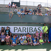 March 7, 2015, Indian Wells, California:<br /> Kids pose for a photograph with Denis Kudla and Rajeev Ram during Kids Day at the Indian Wells Tennis Garden in Indian Wells, California Saturday, March 7, 2015.<br /> (Photo by Billie Weiss/BNP Paribas Open)