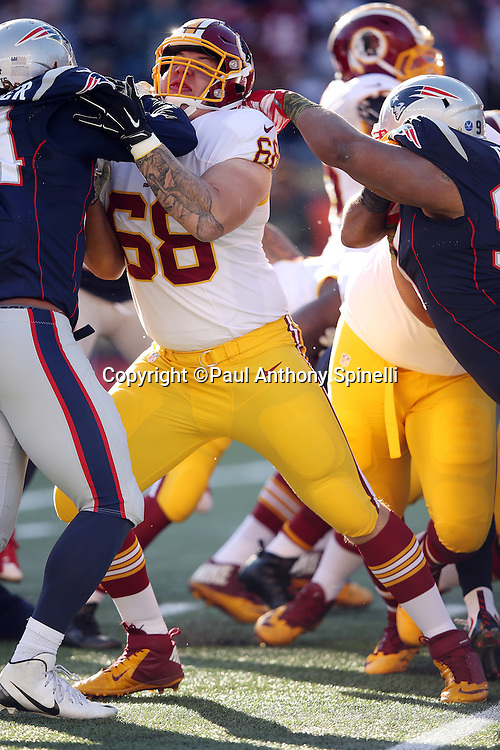 Washington Redskins tackle Tom Compton (68) blocks during the 2015 week 9 regular season NFL football game against the New England Patriots on Sunday, Nov. 8, 2015 in Foxborough, Mass. The Patriots won the game 27-10. (©Paul Anthony Spinelli)