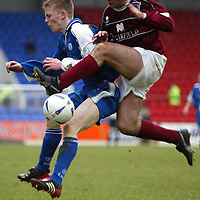 St Johnstone v Arbroath.. 08.03.03<br />Mark Baxter is tackled by Steven Florence<br /><br />Pic by Graeme Hart<br />Copyright Perthshire Picture Agency<br />Tel: 01738 623350 / 07990 594431