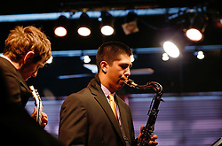 On the saxophone is BrandonLee Cierley and Elliott Turner on guitar with the PLU Jazz Ensemble at Tula's Jazz Club in Seattle on Sunday, May 3, 2015. (Photo: John Froschauer/PLU)