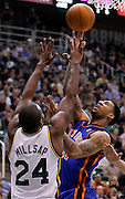New York Knicks forward Wilson Chandler, right, attempts to score against Utah Jazz forward Paul Millsap, left, during the first half of an NBA basketball game in Salt Lake City, Wednesday Jan. 12, 2011. (AP Photo/Colin E Braley)