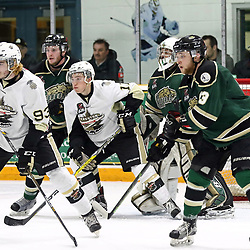 TRENTON, ON - APR 4,  2017: Ontario Junior Hockey League North East Conference Championship game between  Trenton Golden Hawks and the Cobourg Cougars, Austin Tonkovich #93 of the Trenton Golden Hawks and Jordan Chard #11 of the Trenton Golden Hawks attempts to screen goaltender during the third period<br /> (Photo by Ed McPherson / OJHL Images)