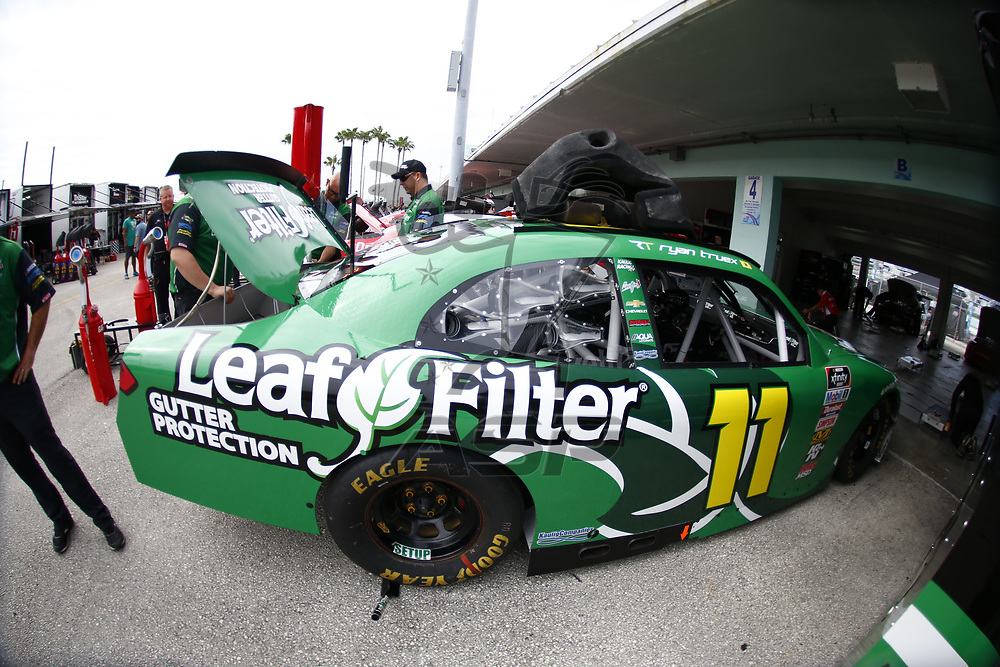 \{persons}n\ hangs out in the garage during practice for the Ford 300 at Homestead-Miami Speedway in Homestead, Florida.