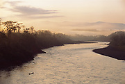 Lower Urubamba River and Locals in Canoe<br />seen from Machiguenga Indian Lodge<br />Amazon Rain Forest, PERU.  South America