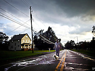 Tom Pesta walks his dog on Riverview in Cuyahoga National Park, OH, at sunset during a summer rainstorm.<br /> <br /> /// ADDITIONAL INFORMATION: 7/21/11 - travel.Lincoln.East.0929  - STUART PALLEY, ORANGE COUNTY REGISTER - Lincoln Highway July 2013. <br /> <br /> Tom is a mold remediater.