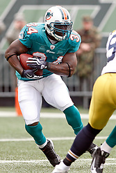 Nov 1, 2009; East Rutherford, NJ, USA; Miami Dolphins running back Ricky Williams (34) runs with the ball during the 1st half of their game against the New York Jets at Giants Stadium. Mandatory Credit: Ed Mulholland
