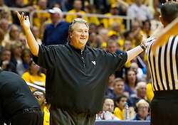 Feb 20, 2016; Morgantown, WV, USA; West Virginia Mountaineers head coach Bob Huggins reacts to a call during the first half against the Oklahoma Sooners at the WVU Coliseum. Mandatory Credit: Ben Queen-USA TODAY Sports