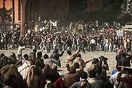Violent clashes between pro and anti Mubarak in Cairo.<br /> Anti Egyptian president demonstrators (bottom) repel Mubarak's supporters after they pushed aggressively inside Tahrir Square, the center of anti-government demonstrations,  hurling stones at each others. 02 February 2011.