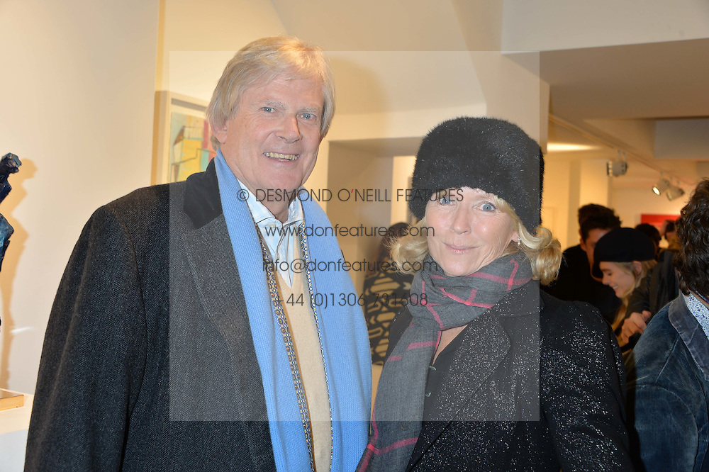 JOHN & VANESSA ANSTRUTHER-GOUGH-CALTHORPE at a private view entitled Stop Making Sense featuring work by Georgiana Anstruther and Carol Corell held at Lacey Contemporary, 8 Clarendon Cross, London on 9th March 2016.