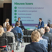 NLD/Den Haag/20190528 - Maxima bij Platform Wijzer in Geldzaken, Koningin Maxima en minister Wopke Hoekstra