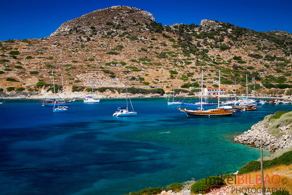 Bay and sailing ships near Knidos ancient Greek city ruins.<br /> Datca peninsula, Mugla province, Turkey.
