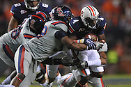 Auburn wide receiver Quan Bray (4) is tackled by Ole Miss' Mike Marry (52) at Jordan-Hare Stadium in Auburn, Ala. on Saturday, October 29, 2011. .