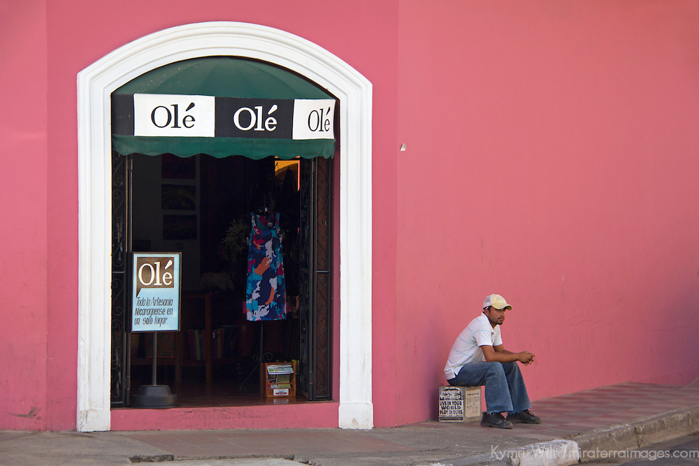 Central America, Nicaragua, Granada. Local man sits outside Ole Shop in Granada.
