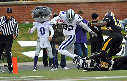 Nov 13, 2010; Columbia, MO, USA; Kansas State Wildcats wide receiver Adrian Hilburn (82) is tackled by Missouri Tigers safety Jasper Simmons (9) in the second half at Memorial Stadium. Missouri won 38-28. Mandatory Credit: Denny Medley-US PRESSWIRE