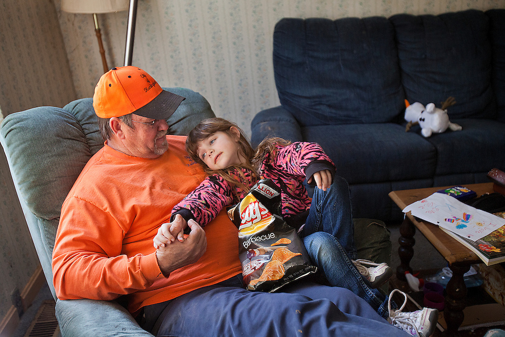 Dale Payne listened to Kiera Volz as she told him about her day after school his Huntingburg home March 20. Dale, who has known Kiera since she was born, has helped raise her since July 2010 and became her legal guardian in October 2011.