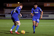 AFC Wimbledon midfielder Tyler Burey (32) exchanging passes with AFC Wimbledon midfielder Alfie Eagan (28) during the EFL Trophy group stage match between AFC Wimbledon and Stevenage at the Cherry Red Records Stadium, Kingston, England on 6 November 2018.