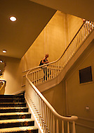 Tori ascends the stair case in the Bourbon Hotel.  She was on her way to the second floor ballroom, now used as a conference room.  It is replicated in the Haunted Mansion at Disneyland.