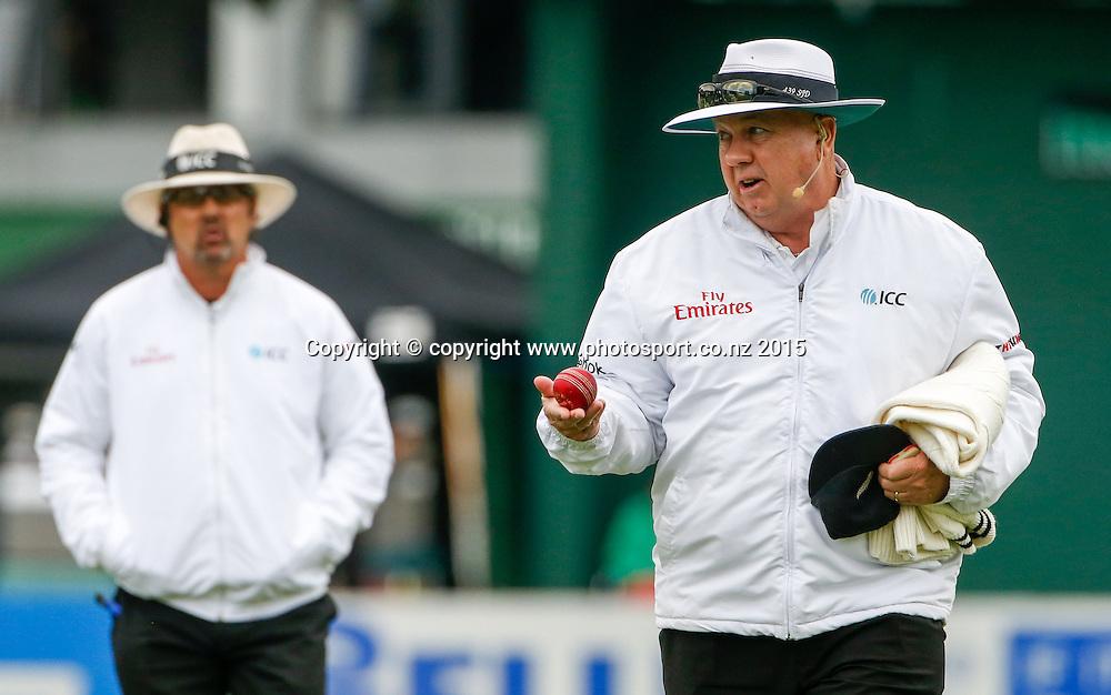 Umpire Steve Davis with another damaged ball. Fourth day, second test, ANZ Cricket Test series, New Zealand Black Caps v Sri Lanka, 06 January 2015, Basin Reserve, Wellington, New Zealand. Photo: John Cowpland / www.photosport.co.nz