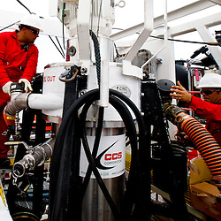 Workers operate the Ocean Therapy Solutions oil separating centrifuge device that will be deployed by BP Plc for oil spill clean up efforts is demonstrated on a vessel at Hornbeck Offshore in Port Fourchon, Louisiana, U.S., on Tuesday, June 15, 2010. (Mandatory Credit: Derick E. Hingle)