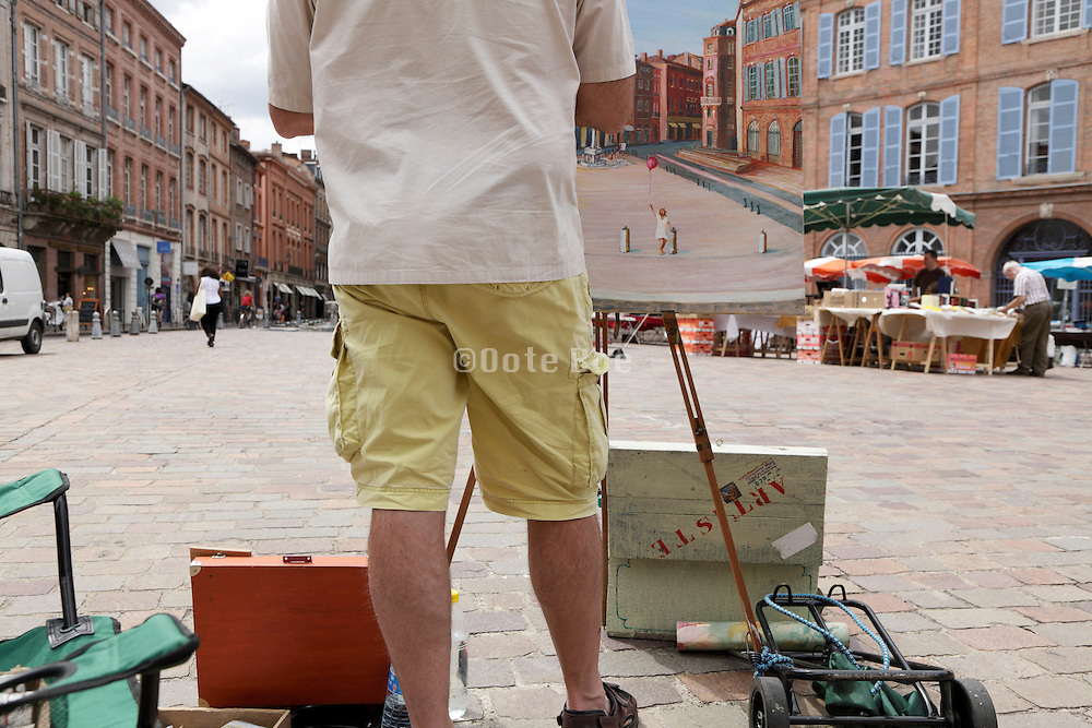 artist painting a city square scene in Toulouse France