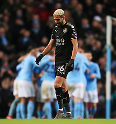 Riyad Mahrez of Leicester City looks dejected as Sergio Aguero of Manchester City celebrates after scoring his hat-trick goal to make it 4-1 - Mandatory by-line: Matt McNulty/JMP - 10/02/2018 - FOOTBALL - Etihad Stadium - Manchester, England - Manchester City v Leicester City - Premier League