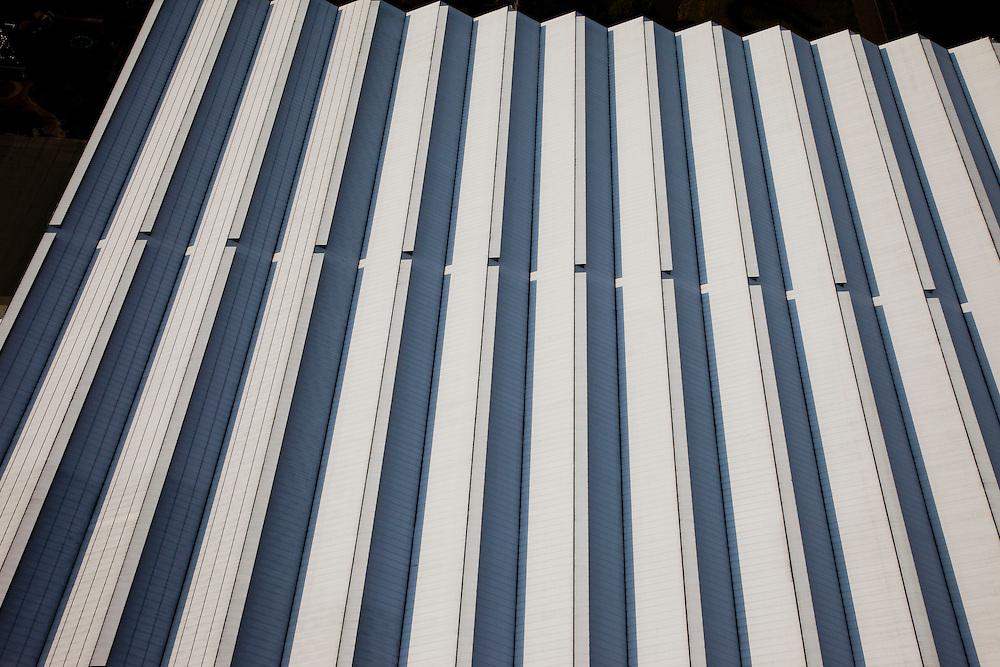 Nederland, Zuid-Holland, Westland, 19-09-2009; geometrische patronen van daken van kassen met slagschaduwen;.geometric patterns of roofs of greenhouses with drop shadows.luchtfoto (toeslag), aerial photo (additional fee required).foto/photo Siebe Swart