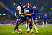 Chelsea midfielder Ross Barkley (8) holds Tottenham Hotspur defender Serge Aurier (24) during the EFL Cup semi final second leg match between Chelsea and Tottenham Hotspur at Stamford Bridge, London, England on 24 January 2019.