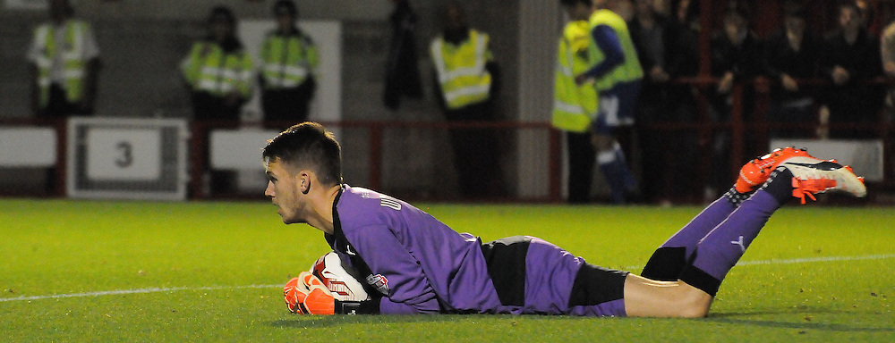 Freddie Woodman clings onto the ball during the Sky Bet League 2 match between Crawley Town and Portsmouth at the Checkatrade.com Stadium, Crawley, England on 18 August 2015. Photo by Michael Hulf.