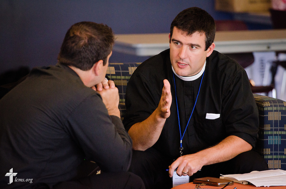 The Rev. Bryan Wolfmueller, pastor of Hope Lutheran Church in Aurora, Colo., chats with the Rev. Ross Johnson, LCMS director of Disaster Response, during a break in activities at the 2014 Institute on Liturgy, Preaching and Church Music on Tuesday, July 29, 2014, at Concordia University, Nebraska, in Seward, Neb. LCMS Communications/Erik M. Lunsford