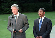 US President Bill Clinton flanked by Transportation Secretary Rodney Slater speak to the media on the South Lawn of the White House lawn September 10, 1998 in Washington, DC. Clinton announced a tentative settlement in the 13-day-old strike by Northwest Airline pilots.