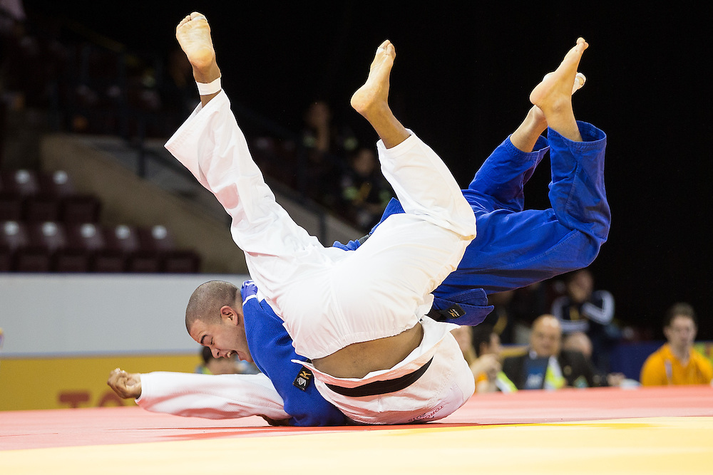 Antony Pena (top) of Venezuela throws Luciano Correa of Brazil in their men's judo -100kg class contest at the 2015 Pan American Games in Toronto, Canada, July 14,  2015.  AFP PHOTO/GEOFF ROBINS