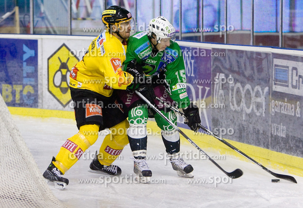 Philippe Lakos vs Egon Muric during 52nd Round of EBEL league ice-hockey match between HDD Tilia Olimpija, Ljubljana and EV Vienna Capitals, on February 7, 2010 in Arena Tivoli, Ljubljana, Slovenia. Vienna defeated Olimpija 8-2. (Photo by Vid Ponikvar / Sportida)