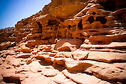 The Coloured Canyon of Egypt<br /> <br /> The Coloured Canyon is a narrow slot canyon located near the town of Nuweiba, on Sinai peninsula, Egypt, so named because of its amazing spectrum of colours and banding. The canyon was formed by water erosion millions of years ago when this region was submerged under the ocean. It's almost 800 meters long and flanked by walls 40 meters high. The sandstone walls are coloured with a range of hues from dark brown to red to straw yellow, which appears so due to the presence of magnesium and iron oxides. The canyon is little more than a meter wide at some parts, and sometimes blocked by fallen boulders that visitors have to climb over in order to proceed. The canyon is easy to reach and its short length makes it perfect for hiking.<br /> ©Exclusivepix Media