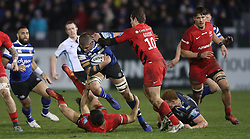 Bath's Tom Ellis is tackled by Saracens Alex Lozowski and Alex Goode during the Gallagher Premiership match at the Recreation Ground, Bath.