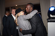 JOCHEN ZEITZ; ANDREA BARRON; USAIN BOLT, Fundraising Gala for the Zeitz foundation and Zoological Society of London hosted by Usain Bolt. . London Zoo. Regent's Park. London. 22 November 2012.