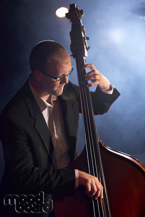 Double bass player on stage portrait